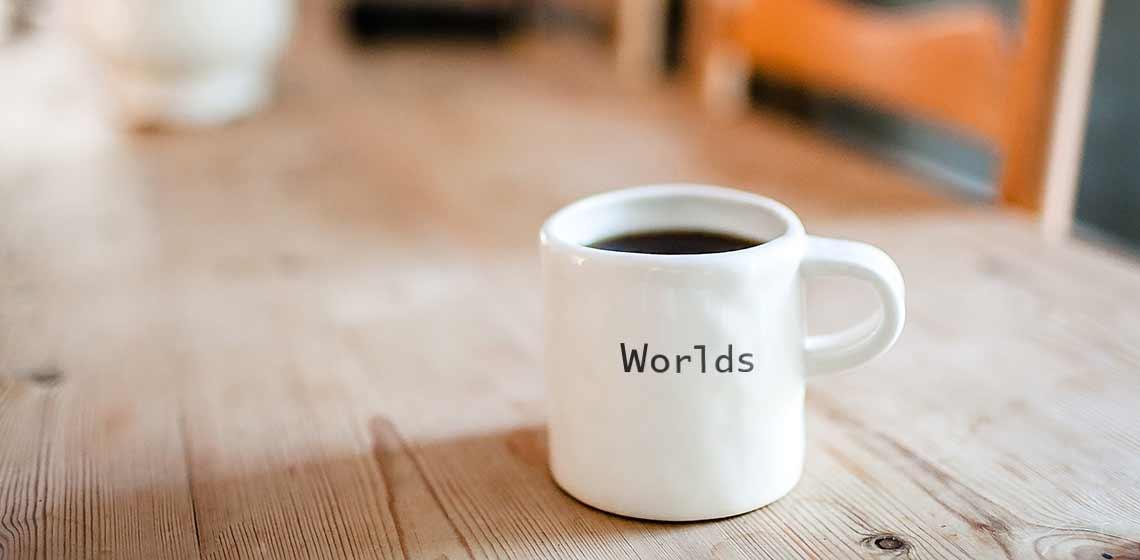 Taza de cafe con la palabra Mundos - Psicólogos Embajadores Madrid